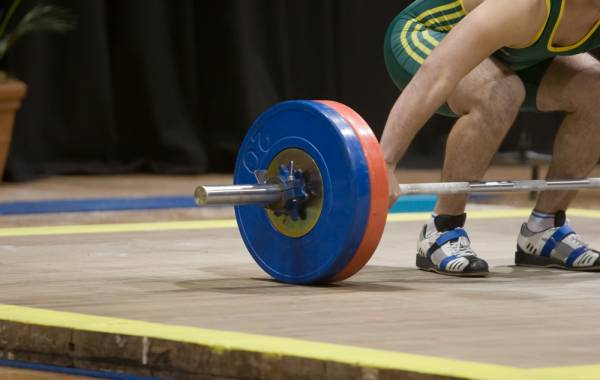 Accessories to Help Perfect Your Squats - Weightlifting shoes while squatting