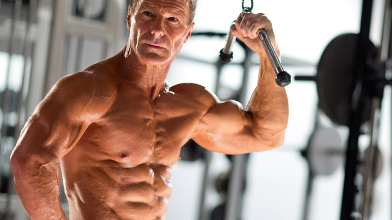 Gaining Muscle Over 50 - Muscular Man on Lat Pull Down Machine