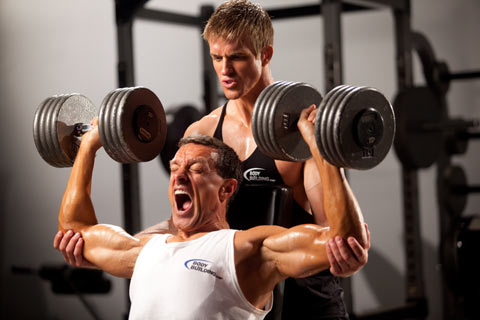 Gaining Muscle Over 50 - Man working with Trainer